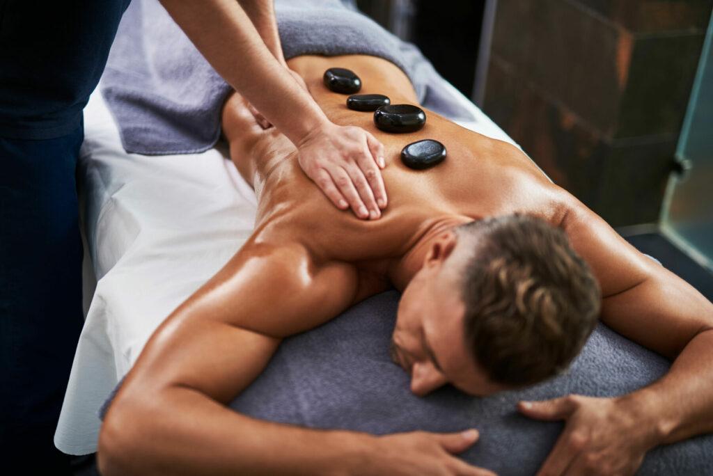 masseur massaging client body